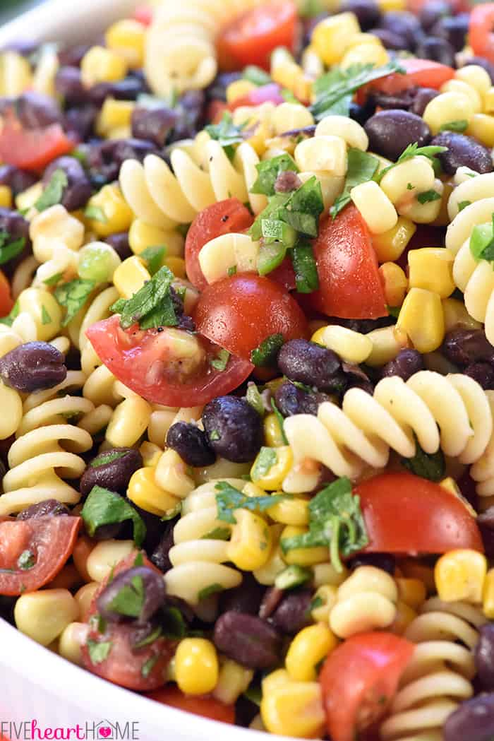 Close-up of Fiesta Pasta Salad with with corn, black beans, tomatoes, jalapeño, and cilantro