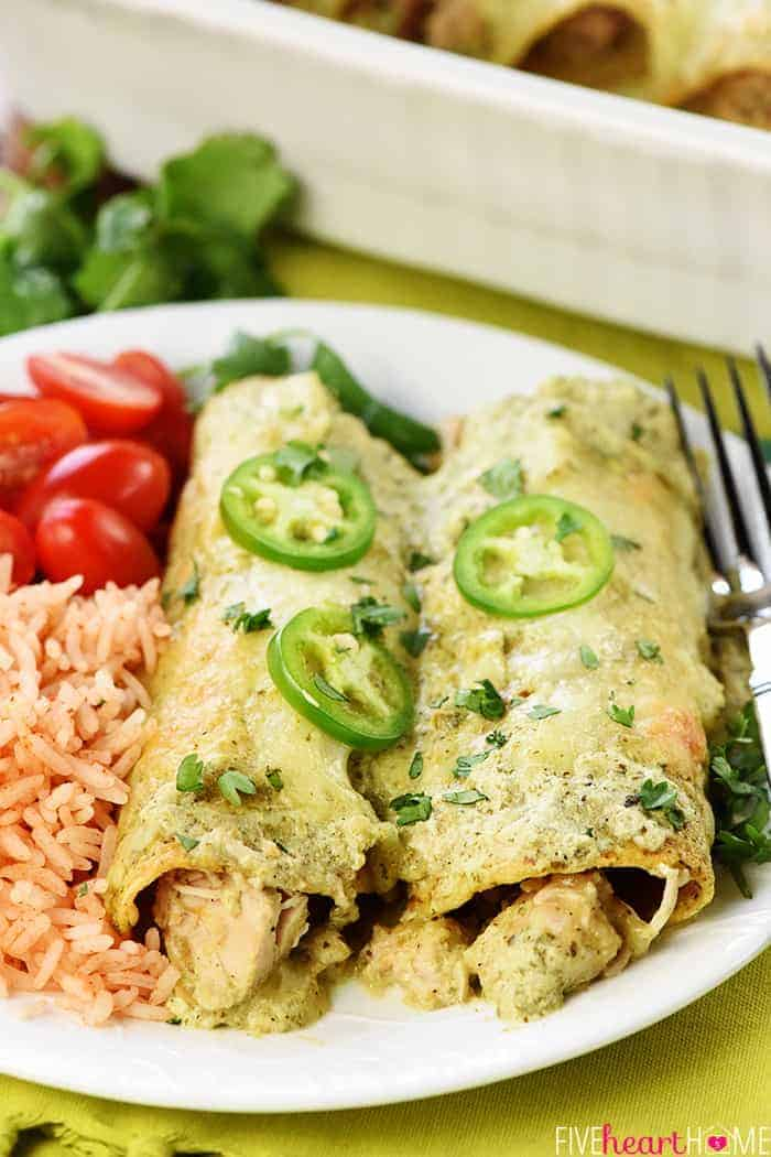 Creamy Jalapeño Chicken Enchiladas Served on White Plate with Sides