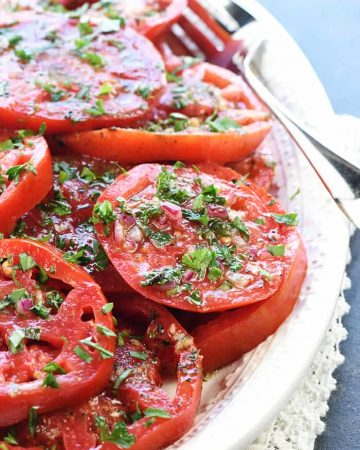 The BEST Marinated Tomatoes ~ ripe, juicy tomatoes soak up olive oil, red wine vinegar, onion, garlic, & fresh herbs in this zesty summer salad or versatile side dish! | FiveHeartHome.com