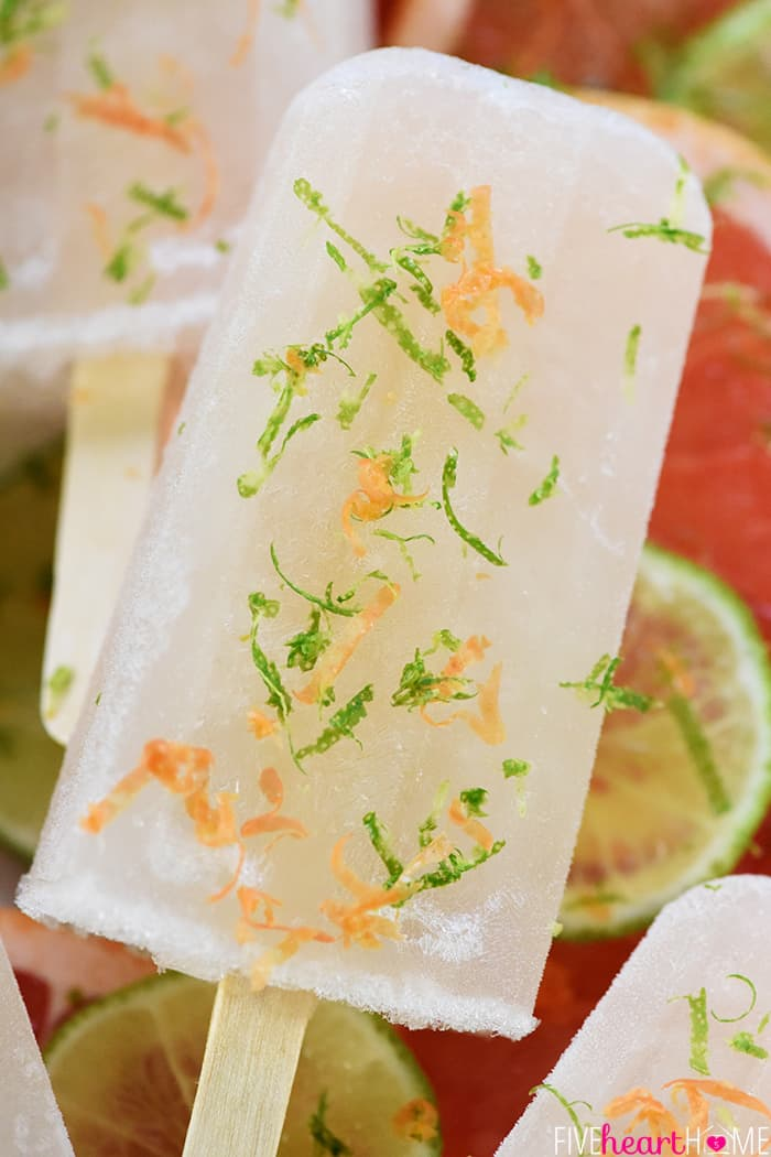 Ruby Red Moscow Mule Popsicles ~ made with ginger beer, ruby red vodka, fresh lime juice, and grapefruit simple syrup for a frosty, boozy, summer treat! | FiveHeartHome.com