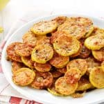 Baked Parmesan Yellow Squash Rounds Recipe ~ an easy and delicious summer side dish requiring just two ingredients: yellow squash and grated Parmesan! | FiveHeartHome.com