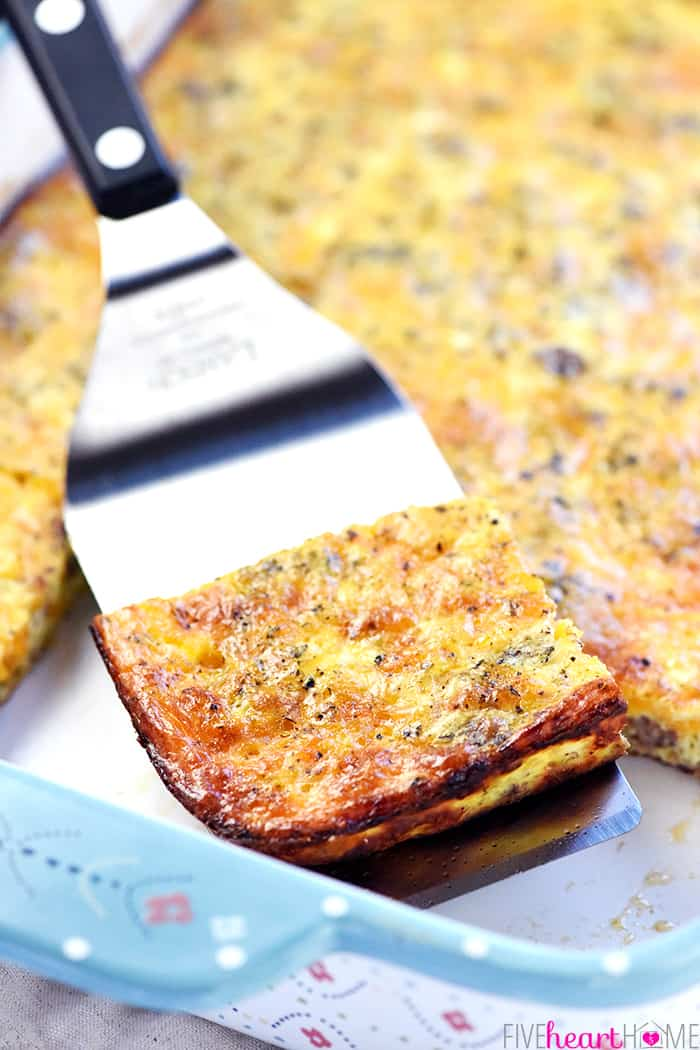 Slice of Breakfast Casserole on spatula being lifted out of baking dish