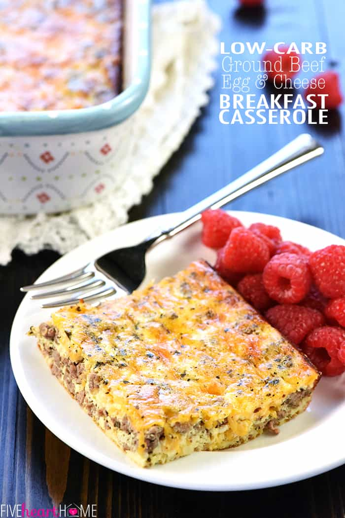 Ground Beef, Egg, & Cheese Breakfast Casserole in baking dish and on white plate with a fork and raspberries, with text overlay