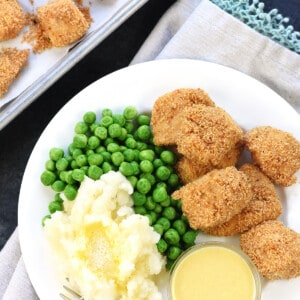 Aerial view of Homemade Chicken Nuggets on a plate with sides.
