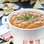 Hot Taco Dip ~ warm, creamy, and loaded with taco seasoned beef, cream cheese, cheddar, salsa, and cilantro for a popular party appetizer or football tailgating recipe! | FiveHeartHome.com