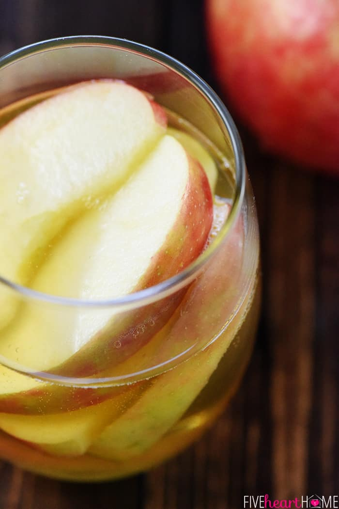 3-Ingredient Sparkling Apple Cider Sangria Recipe ~ a festive fall cocktail featuring white wine, apple cider, and sweet sliced Honeycrisps -- perfect for tailgating, Halloween, Thanksgiving, and even Christmas! | FiveHeartHome.com