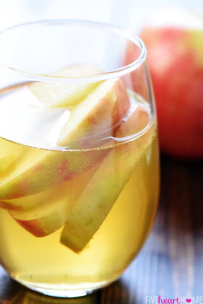 3-Ingredient Sparkling Apple Cider Sangria ~ a festive fall cocktail recipe made with white wine, apple cider, and sweet sliced Honeycrisps -- perfect for tailgating, Halloween, Thanksgiving, and more! | FiveHeartHome.com