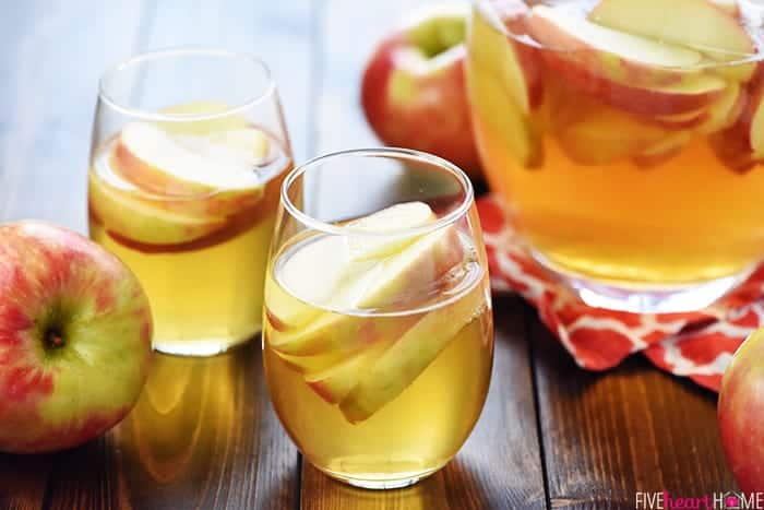 3-Ingredient Sparkling Apple Cider Sangria ~ a festive fall cocktail recipe made with white wine, apple cider, and sweet sliced Honeycrisps -- perfect for tailgating, Halloween, Thanksgiving, and even Christmas!