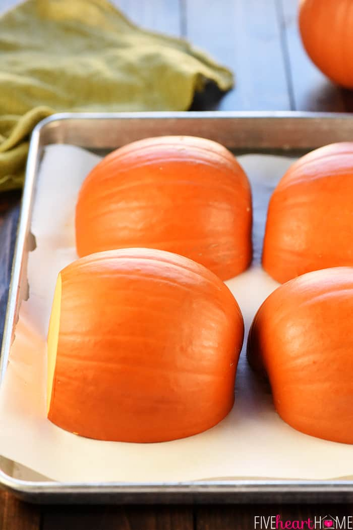 Pumpkins halved and cut side down on pan