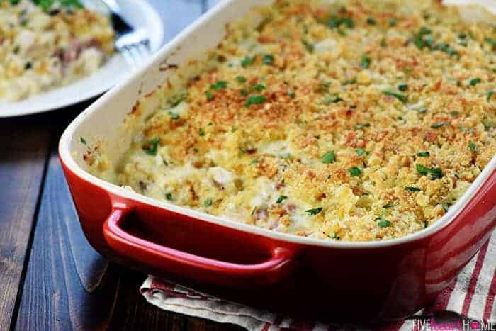 Cordon Bleu Casserole ~ loaded with chicken (or turkey) and ham in a creamy Swiss cheese sauce topped with a layer of toasty bread crumbs for a decadent, delicious dinner...perfect for using up Thanksgiving leftovers! | FiveHeartHome.com