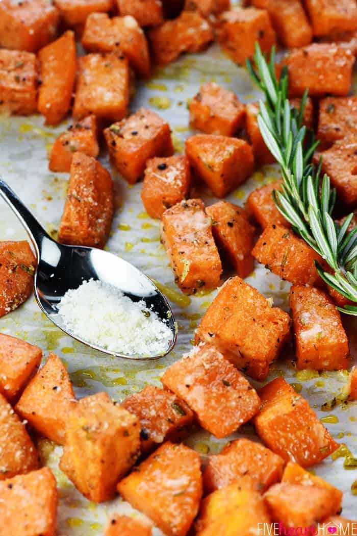 Parmesan Herb Sweet Potatoes with Spoon of Grated Parmesan