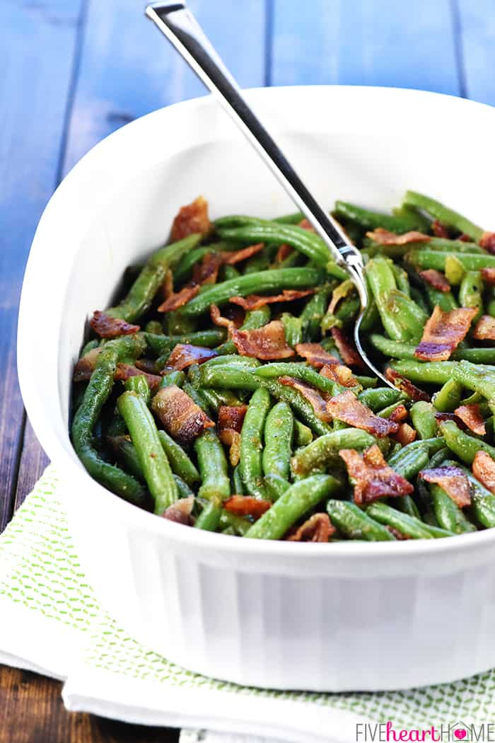 Green Beans with Bacon in serving dish with spoon.