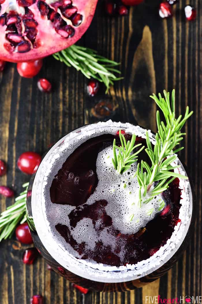 Aerial View of Alcoholic Christmas Punch with Sprig of Rosemary