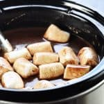 Slow Cooker Hot Chocolate ~ using a crock pot is the easiest way to make a big batch of rich, decadent hot cocoa for a crowd, and four flavor variations make it extra yummy: regular, salted caramel, peppermint, and Mexican hot chocolate! | FiveHeartHome.com