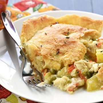 The BEST Chicken Pot Pie ~ features juicy chicken and tender veggies under a flaky, buttery crust for a delicious comfort food classic! | FiveHeartHome.com