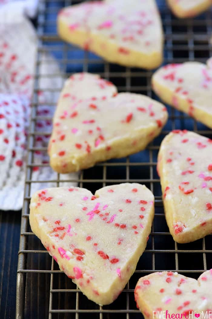 Heart cookies cooling on rack.
