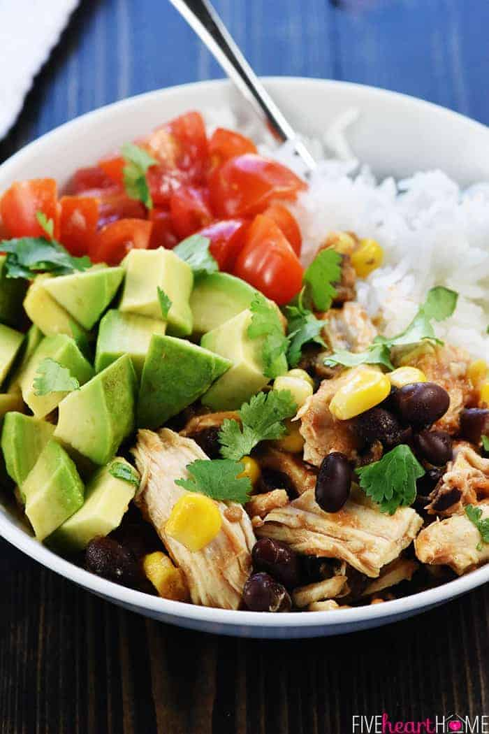 Pressure Cooker Chicken Burrito Bowl with Diced Tomato, Avocado and Rice in White Bowl