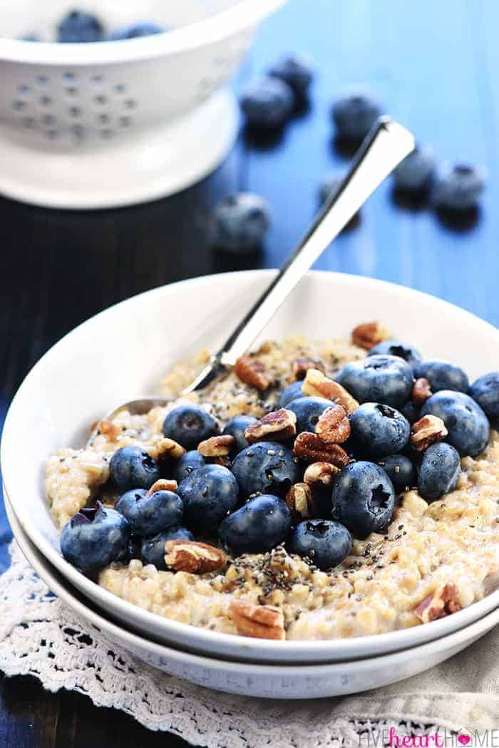 Oatmeal Topped with fresh blueberries in a bowl