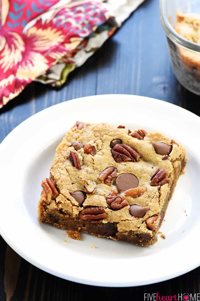Chewy Blondies Recipe with pecans and chocolates on white plate