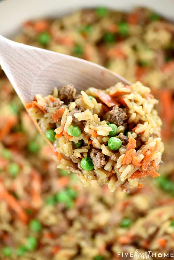 Wooden spoon scooping up Asian Ground Beef and Rice recipe.