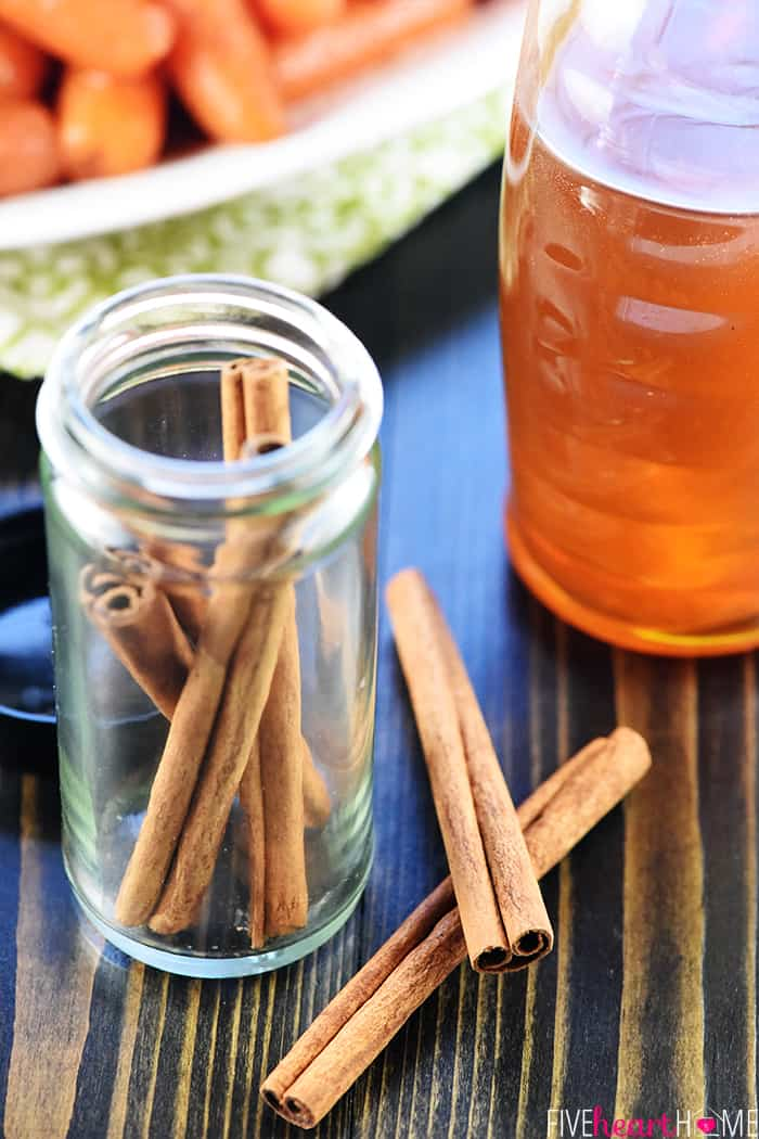 Close up of cinnamon and honey with carrots