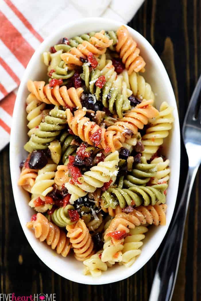 Bowl of rotini and Italian ingredients