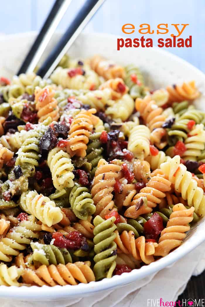Easy Pasta Salad Recipe ~ tri-color garden rotini is studded with diced olives and pimentos, tossed with a zesty homemade Italian dressing, and showered with Parmesan for a versatile summer side dish! | FiveHeartHome.com