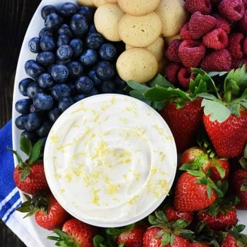 Lemon Cream Cheese Dip, aerial view on platter with fruit and cookies.