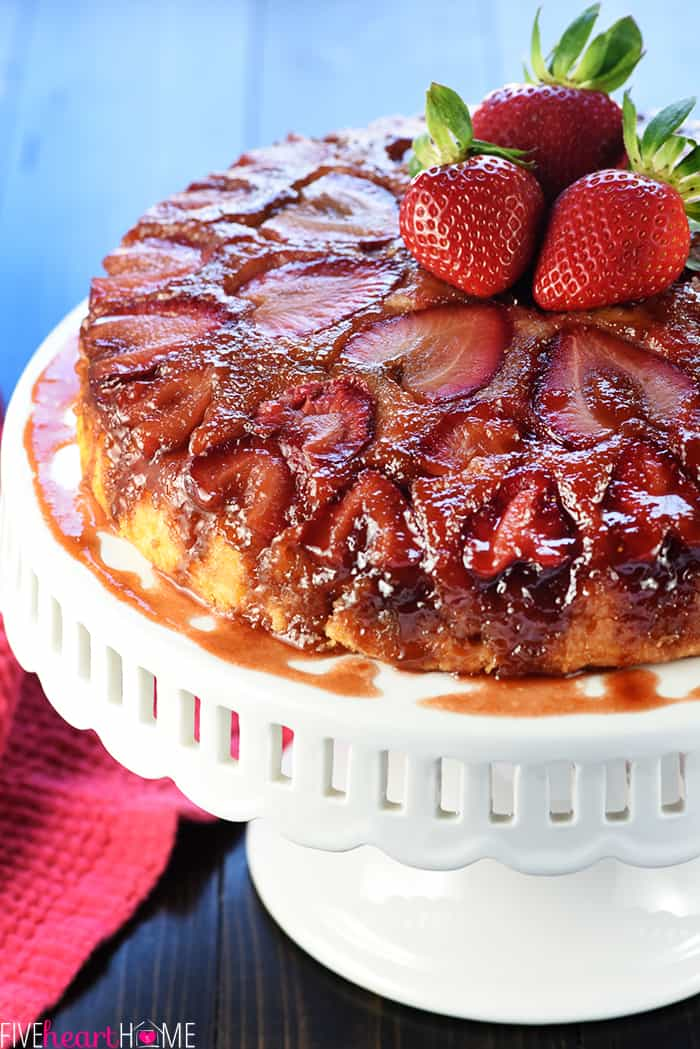 Easy Strawberry Upside Down Cake on a stand
