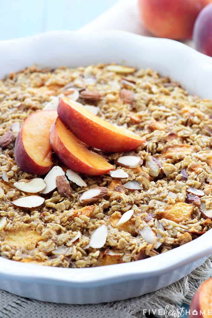 Peach Baked Oatmeal in baking dish with sliced peaches on top.