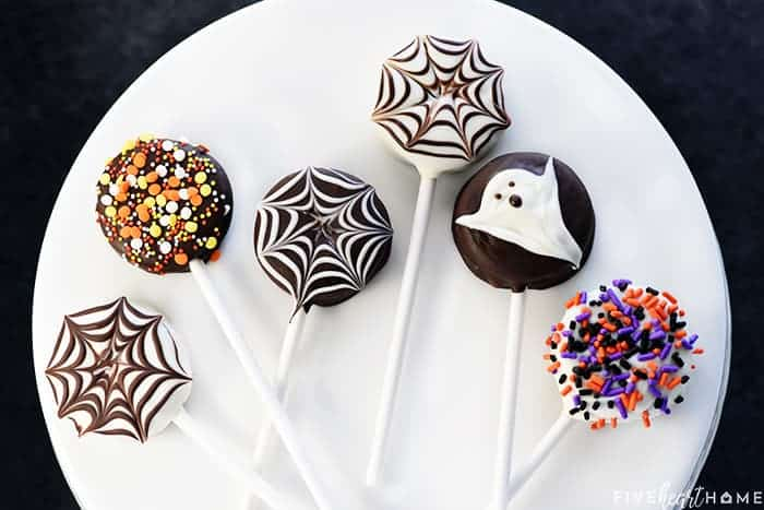 Halloween Oreo Pops ~ cute, yummy, and fun to make with the kids, featuring spiderwebs, ghosts, and (of course!) colorful sprinkles! | FiveHeartHome.com