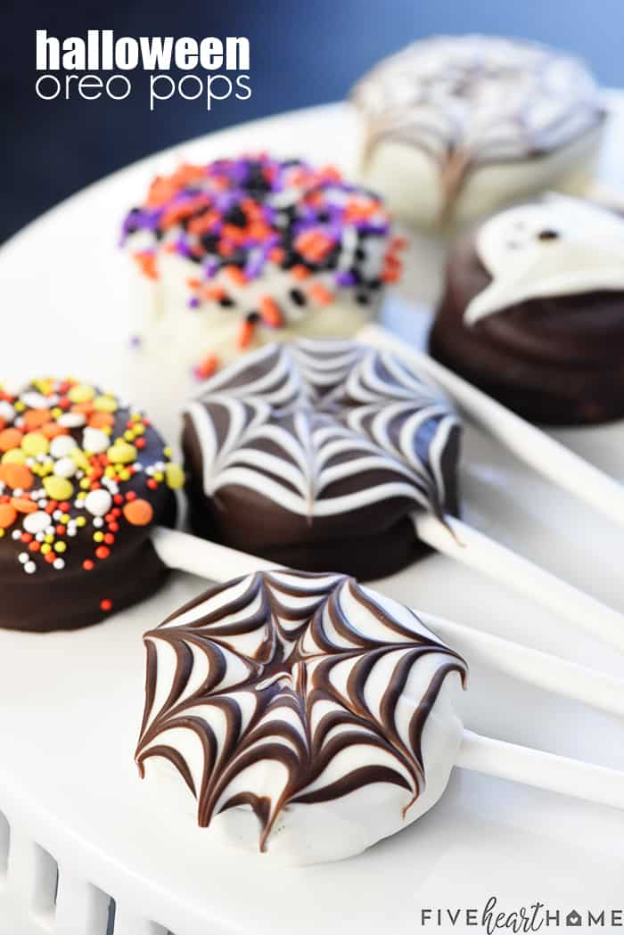 Halloween Oreo Pops Recipe ~ cute, yummy, and fun to make with the kids, featuring spiderwebs, ghosts, and (of course!) colorful sprinkles! | FiveHeartHome.com