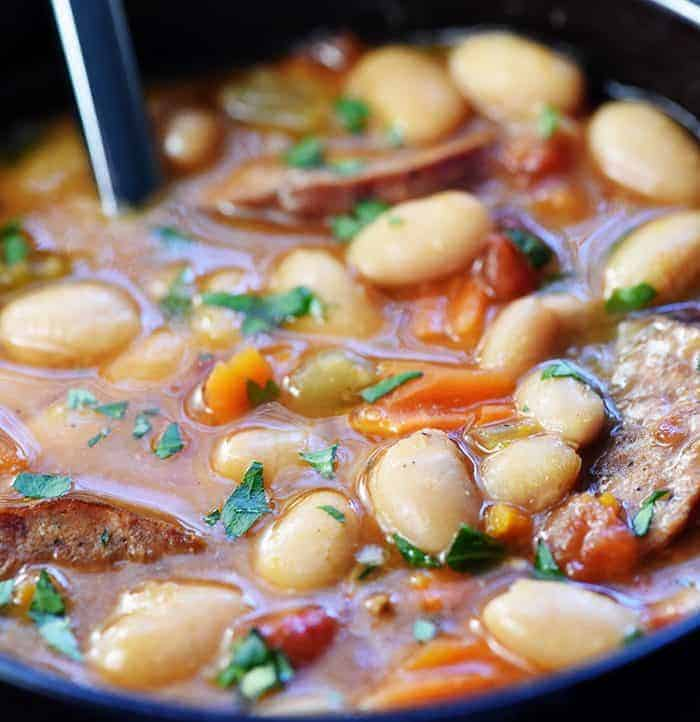 Slow Cooker Cajun White Bean Soup ~ a cozy crock pot recipe loaded with beans, andouille sausage, veggies, and a flavorful broth that's sure to warm you up! | FiveHeartHome.com