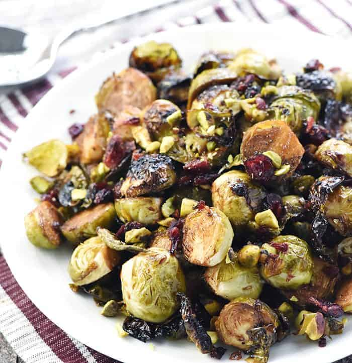 Balsamic Roasted Brussels Sprouts with Pistachios & Cranberries ~ crispy and addictive, this special holiday side dish recipe is perfect for Thanksgiving or Christmas but also easy enough for everyday!   FiveHeartHome.com