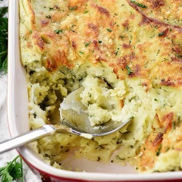 Make-Ahead Garlic & Herb Mashed Potatoes ~ a creamy, decadent holiday side dish loaded with mellow garlic & fresh herbs and topped with a golden Parmesan crust...perfect for Thanksgiving, Christmas, Easter, or entertaining company! | FiveHeartHome.com