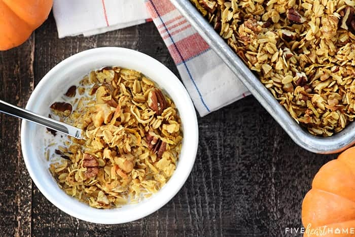 Healthy Pumpkin Granola ~ crunchy, golden, and easy to make, loaded with wholesome oats, toasty nuts, real pumpkin puree, coconut oil, maple syrup, & warm fall spices! | FiveHeartHome.com