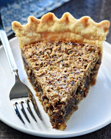The BEST Pecan Pie ~ foolproof and perfect every time, with an abundance of toasty pecans floating on a thick, glossy filling in a flaky, all-butter pie crust! | FiveHeartHome.com