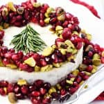 Christmas Brie ~ a simple, red-green-and-white holiday appetizer featuring Brie, pomegranate, and pistachios, garnished with a festive rosemary Christmas tree! | FiveHeartHome.com
