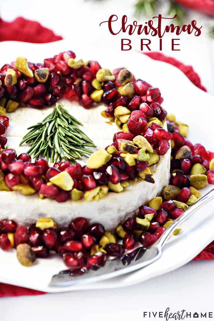 Christmas Brie Recipe ~ a simple, red-green-and-white holiday appetizer featuring Brie, pomegranate, and pistachios, garnished with a festive rosemary Christmas tree! | FiveHeartHome.com