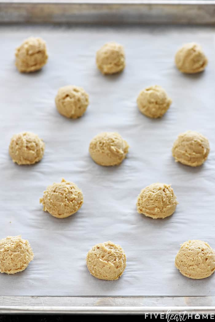 Batter Dropped on Parchment Paper Lined Cookie Sheet