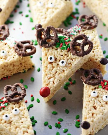 Reindeer Rice Krispie Treats arranged on baking sheet.
