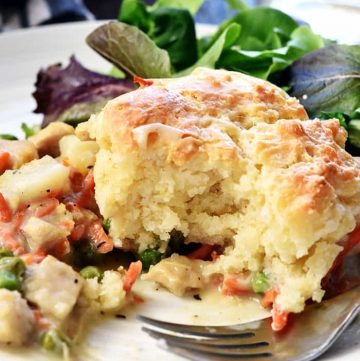 Chicken Pot Pie Casserole ~ this easy comfort food recipe features a classic filling of tender chicken, potatoes, carrots, and peas in a savory gravy topped with fluffy homemade drop biscuits! | FiveHeartHome.com