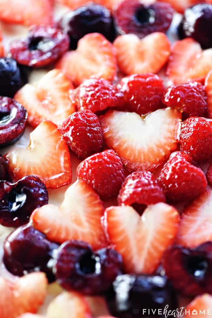 Valentine's Dessert Fruit Pizza with strawberries, raspberries, and cherries