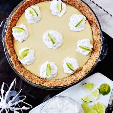 Key Lime Pie with Pretzel Crust & Coconut Whipped Cream ~ a classic Key Lime Pie filling is taken over the top with a sweet and salty pretzel crust and fresh coconut whipped cream! | FiveHeartHome.com
