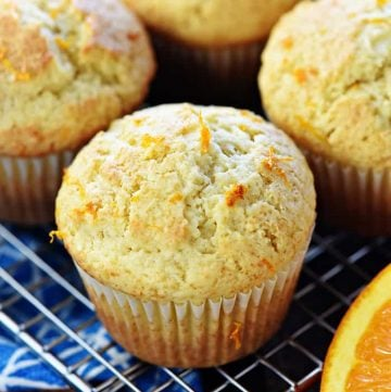 Orange Muffins ~ these lovely muffins are tender, and easy to make from scratch, with delicate flavors of vanilla and citrus from fresh orange juice and zest! | FiveHeartHome.com