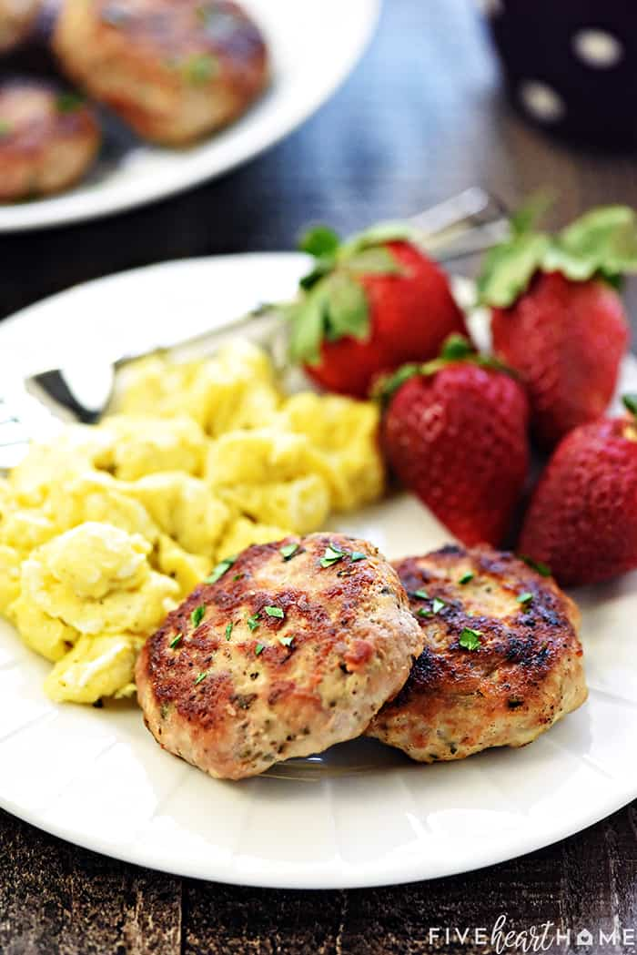 Breakfast Sausage on a plate with eggs and strawberries