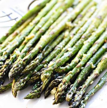 Roasted Asparagus ~ simply seasoned with olive oil, garlic, salt, and pepper for a delicious, easy, versatile, springtime side dish! | FiveHeartHome.com