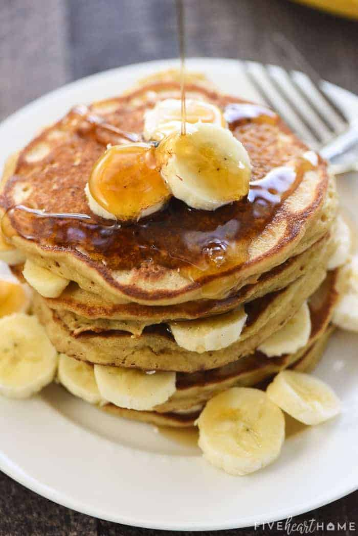Banana Pancakes with maple syrup being poured on top