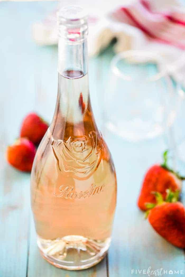 bottle of rosé wine and fresh strawberrries