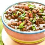 Slow Cooker Charro Beans ~ flavored with bacon, garlic, tomatoes, green chiles, jalapeños, cilantro, and spices, this crock pot recipe is the perfect side dish for Mexican food! | FiveHeartHome.com